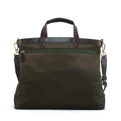 The reversible Strand Briefcase in Forest Green is built with nylon and brown full-grain leather accents. Equal parts function and style, an inner rebel emerges for an alternative mood when reversed.