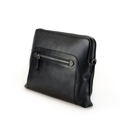 The leather Aramis offers the versatility of clutching or slinging it cross body, exuding stellar style meets functionality. Limited Quantities.