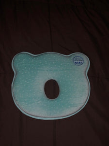Blue flat head prevention pillow