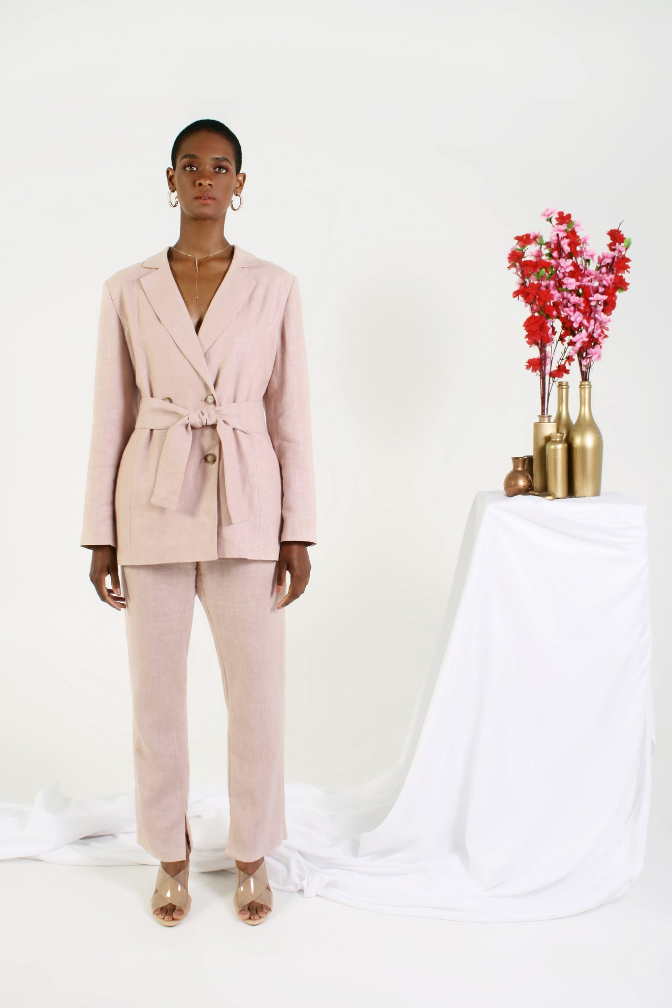 pink blazer on model women's suiting