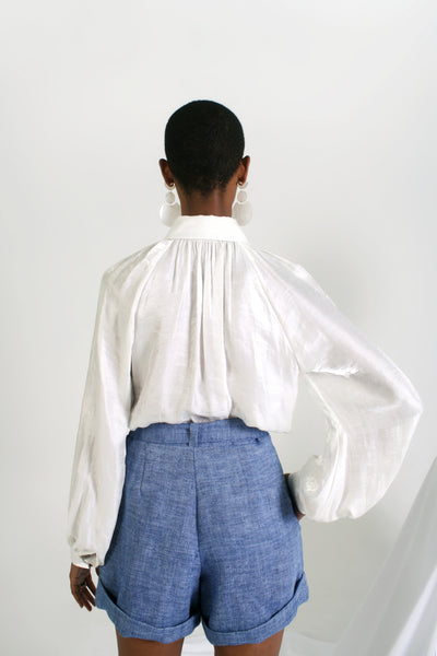 back of belted chambray short