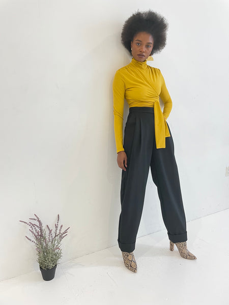 Mustard yellow wrap top on model
