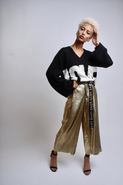 gold wide leg pant on model