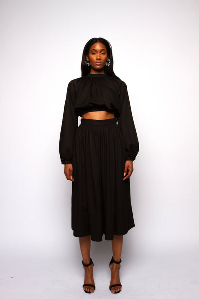 Black exaggerated sleeve crop top on model