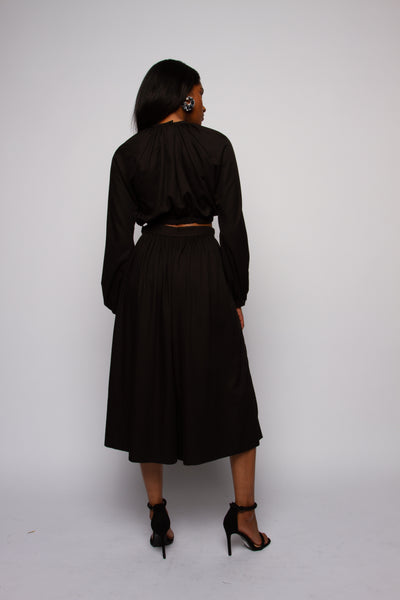 Black exaggerated sleeve crop top and wide leg pant