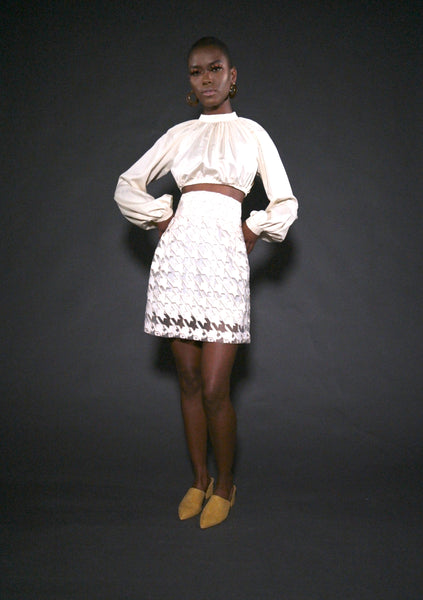 cream herringbone skirt on model