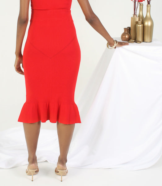 back of red knit trumpet skirt