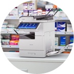 RICOH tabletop multifunction copier in office supplies room