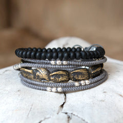 Casted alligator skin and layered bracelets for Burning Man.