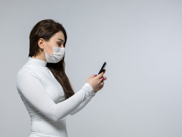Woman holding an antimicrobial phone case