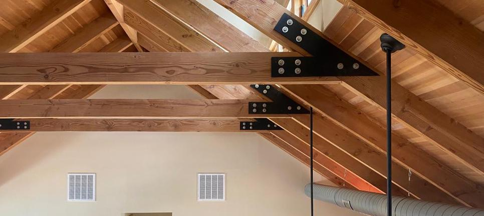 Custom collar tie plates on a clerestory ceiling