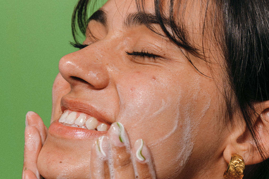 girl cleansing face