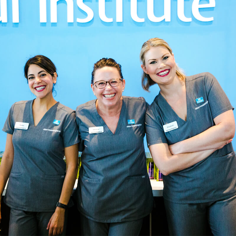 three skin care professionals smiling