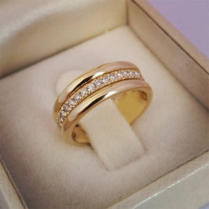 Classic Wedding Ring With Middle Paved CZ Stones