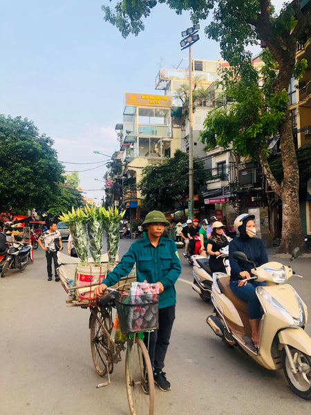 Man carrying flowers in vietnam