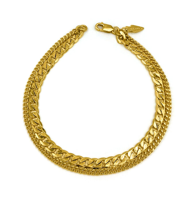 Two gold curb link chains different in size attached together to make beautiful bracelet