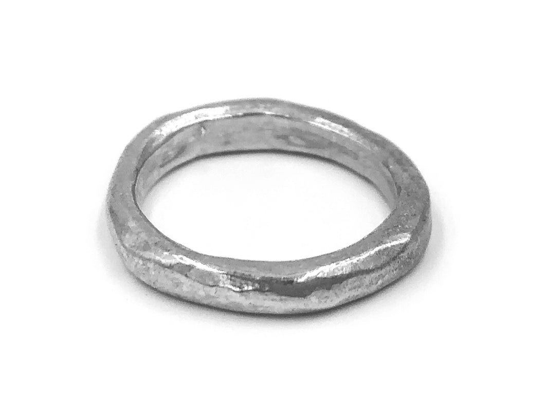 Silver ring with rough,  uneven surface