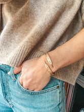 Load image into Gallery viewer, Image of gold shoelace cuff on wrist