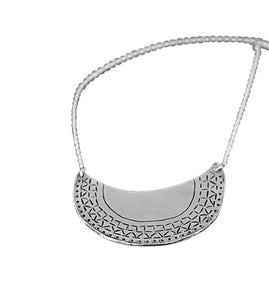 half moon shaped necklace  with tribal pattern around edge
