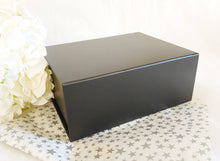 Load image into Gallery viewer, Black Magnetic Gift Box zoom with silver star tissue paper
