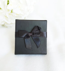 Black Card Ring Box with attached Satin Ribbon Bow and Foam Insert top