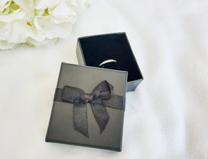 Black Card Ring Box with attached Satin Ribbon Bow and Foam Insert title