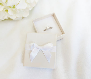 Ivory Card Ring Box with attached Satin Ribbon Bow and Foam Insert title