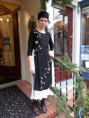 model in double layered boho chic tunic dress black, with embroidered red rose vine, western eastern fusion of style.