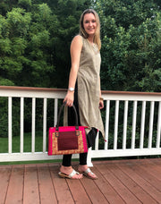 hot pink and brown cotton print handbag paired with beige geometric print tunic.