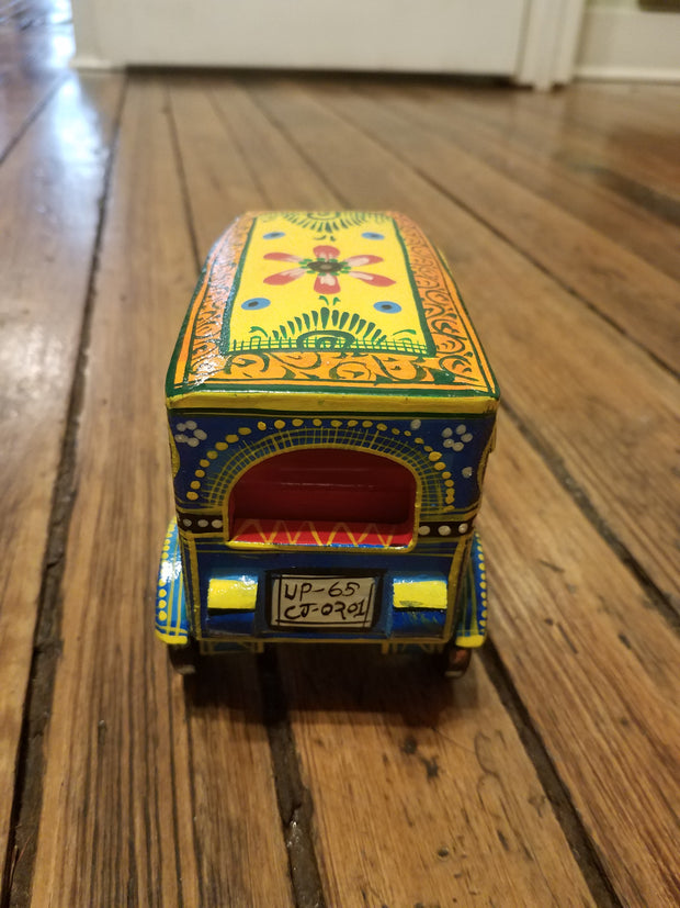 handmade in India, artisan crafted wood tabletop decor, toy auto rickshaw tuk-tuk yellow.
