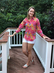 colorful happy pink floral screen print, cotton long sleeve women's shirt with contrast trim and fabric covered buttons.