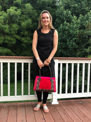 model wearing hot pink, red and brown cotton print handbag with faux leather strap