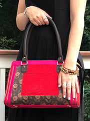 hot pink, red and brown cotton handbag paired with red and black tribal bracelet