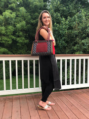 model wearing navy burgundy cotton printed boho chic handbag with black tunic and tights