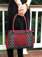 navy burgundy cotton printed boho chic handbag paired with a solid black tunic top.