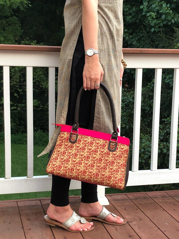 floral print hot pink and brown cotton handbag with faux leather strap