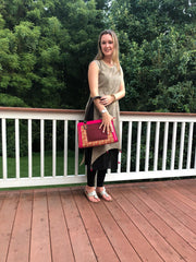 model holding hot pink and brown cotton print handbag with faux leather strap