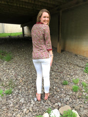 back view of cotton boho chic short tunics, block print, fine sequence trim, sported with white denim jeans.