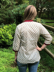 back view of cotton comfort boho chic print cotton short tunic with 3/4th long sleeves paired with denim jeans.