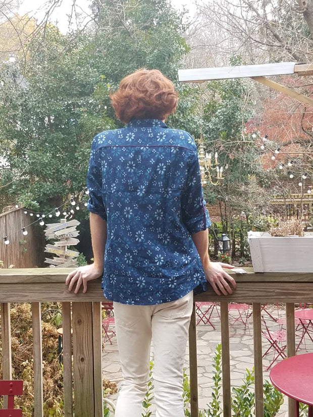 back view of European fit, cotton block print shirt for men, rolled up sleeves, for an elegant edgy look, paired with white pants.