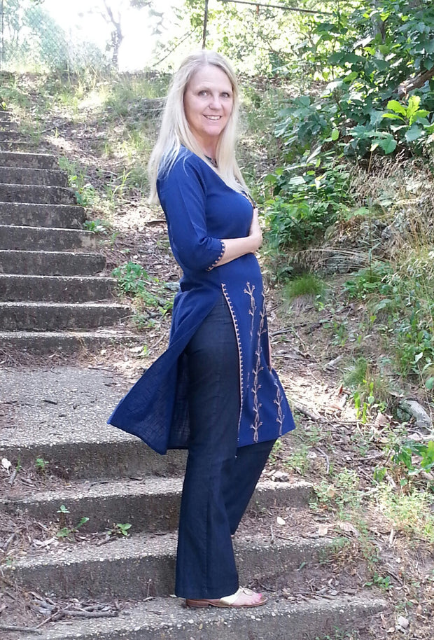 long linen tunic navy with tribal embroidery on front panel in tan, 3/4th long sleeves paired with navy pants.