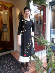 model in double layered boho chic tunic dress black, with embroidered red rose vine, and 3/4th long sleeves.