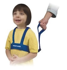 Child wearing safety harness