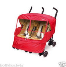 twin stroller with Manito castle Alpha stroller cover in red