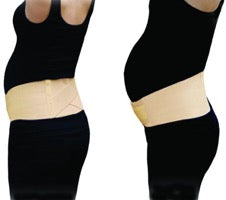 pregnant woman wearing beige maternity support belt