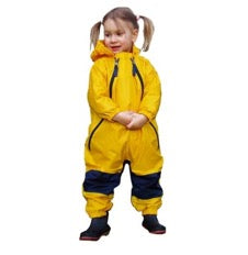 girl in pigtails wearing yellow Muddy Buddy waterproof coveralls