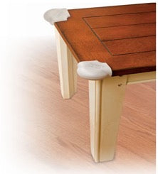 wooden table with soft corner guards protecting the edges