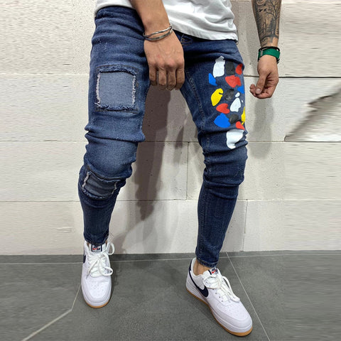 Men's ripped graffiti slim denim trousers