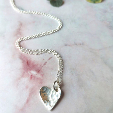 "Silver heart necklace, hammered & slightly domed. The heart measures 13mm & hangs on an 18"" belcher chain. Handmade in Halifax by jeweller Ami Hallgarth. Comes complete with box."