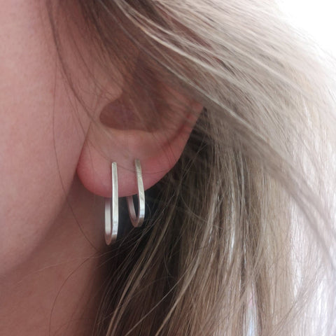Minimal Silver Loop Studs - perfect for anyone who likes to keep their jewellery simple! They are a timeless staple to wear at anytime. Made in Halifax, West Yorkshire, by Ami Hallgarth. Please note it is the longer earring in the picture which you will be buying. Each earring measures 2cm & come boxed.